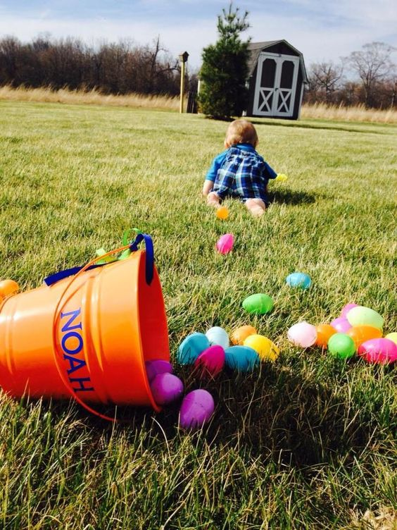 baby crawling away from easter basket
