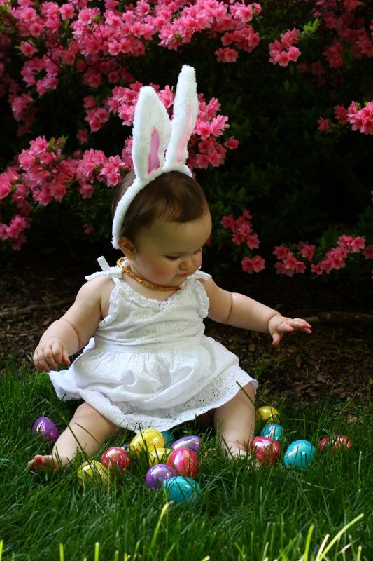 baby with bunny ears and eggs