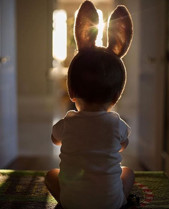 baby with bunny ears on