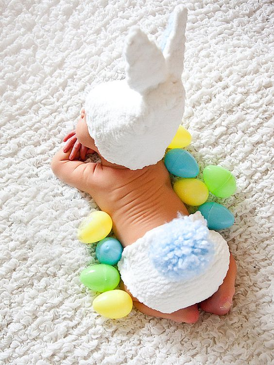 newborn baby with bunny hat and easter eggs
